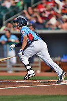 Tennessee Smokies shortstop Elliot Soto #5 swings at a pitch during a game against the Birmingham Barons at Smokies Park on May 31, 2014 in Kodak, Tennessee. The Barons defeated the Smokies 2-1. (Tony Farlow/Four Seam Images)