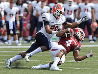 NWA Democrat-Gazette/ANDY SHUPE<br /> Arkansas' Keon Hatcher (4) is tackled by University of Texas at El Paso's Nik Needham Saturday, Sept. 5, 2015, during the first quarter of play in Razorback Stadium in Fayetteville. Visit nwadg.com/photos to see more from the game.