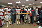 Wisconsin Badgers linebackers celebrates with the Paul Bunyan Axe in the locker room after an NCAA College Big Ten Conference football game against the Minnesota Golden Gophers Saturday, November 25, 2017, in Minneapolis, Minnesota. The Badgers won 31-0. (Photo by David Stluka)