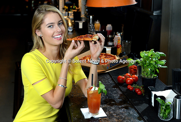 A trendy bar is now serving a new cocktail - made from pizza.  The unique Pepperoni Passion cocktail, made using vodka and a pepperoni pizza, is now on sale for 8.50 pounds.<br /> <br /> It is mixed with tomato and lemon juice, four slices of pepperoni, basil and mozzarella cheese, before being rolled in a cocktail shaker.  The fresh ingredients are then added to the pepperoni infused vodka and then served in a traditional cocktail glass.<br /> <br /> The alcoholic beverage, made using a Pepperoni Passion from Domino's Pizza, was created to coincide with London Cocktail Week.  SEE OUR COPY FOR DETAILS.<br /> <br /> Pictured:  Enjoying the Pepperoni Passion cocktail.<br /> <br /> &copy; Solent News &amp; Photo Agency<br /> UK +44 (0) 2380 458800