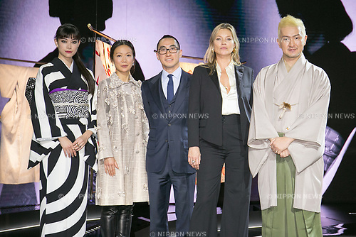 Fashion model Hikari Mori (L), Lawrence Ho chairman and CEO of Melco Resorts and Entertainment Ltd. (C) and his wife (C-L), model Kate Moss (2nd from R) and kabuki actor Shido Nakamura, pose for the cameras during the opening ceremony for the KIMONO ROBOTO exhibition at Omotesando Hills on November 30, 2017, Tokyo, Japan. The exhibition features 13 kimonos created by experts using traditional methods and a humanoid robot dressed in traditional kimono performing in the middle of the hall. The exhibition runs til December 10. (Photo by Rodrigo Reyes Marin/AFLO)