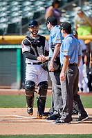 Joe Hudson (7) of the Salt Lake Bees meets the umpire crew before a game against the Fresno Grizzlies at Smith's Ballpark on September 3, 2018 in Salt Lake City, Utah. The Grizzlies defeated the Bees 7-6. (Stephen Smith/Four Seam Images)