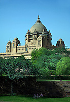 Exterior of UMAID BHAWAN PALACE made of chittar sandstone was built in 1929 and created work in a depressed time - JODHPUR, RAJASTHAN, INDIA