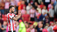 Lincoln City's Neal Eardley applauds the fans at the final whistle <br /> <br /> Photographer Chris Vaughan/CameraSport<br /> <br /> The EFL Sky Bet League Two - Lincoln City v Morecambe - Saturday August 12th 2017 - Sincil Bank - Lincoln<br /> <br /> World Copyright &copy; 2017 CameraSport. All rights reserved. 43 Linden Ave. Countesthorpe. Leicester. England. LE8 5PG - Tel: +44 (0) 116 277 4147 - admin@camerasport.com - www.camerasport.com