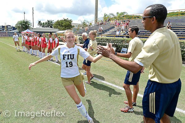 28 September 2014:  FIU Defender Sara Stewart (19) is introduced prior to the start of the match.  The University of North Carolina at Charlotte 49ers defeated the FIU Golden Panthers, 2-1, at University Park Stadium in Miami, Florida.