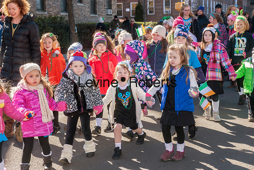 """Children from McManus Irish Dance march in the Sunnyside, Queens St. Patrick's Parade on March 5, 2017. Billed as """"St. Pat's For All"""" the festive event started as an alternative to the New York parade, and organizers have endeavored to make the parade inclusive allowing gays and lesbians to march who were banned from the New York parade. (© Richard B. Levine)"""