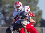 Palos Verdes, CA 10/24/14 - Amir Crear (Redondo Union #5) and Jeff Hector (Peninsula #8)in action during the Redondo Union - Palos Verdes Peninsula CIF Varsity football game at Peninsula High School.
