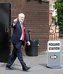 Pic shows: Jeremy Corbyn votes in 2017 general election in school near his home in Islington<br /> <br /> <br /> He walks past a shovel in a bucket on the way into the polling station towards waiting press<br /> <br /> <br /> <br /> <br /> Pic by Gavin Rodgers/Pixel 8000 Ltd