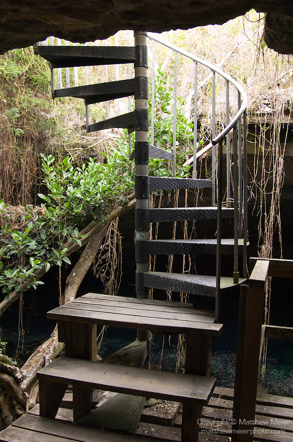 Grand Bahama Island, The Bahamas; the spiral staircase descending into Ben's Cave and the  wooden boardwalk below
