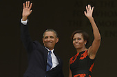 US President Barack Obama (L) and First Lady Michelle Obama (R) wave from the top of the Lincoln Memorial at the conclusion of the 'Let Freedom Ring' commemoration event in Washington DC, USA, 28 August 2013. The event was held to commemorate the 50th anniversary of the 28 August 1963 March on Washington led by the late Dr. Martin Luther King Jr., where he famously gave his 'I Have a Dream' speech.<br /> Credit: Michael Reynolds / Pool via CNP