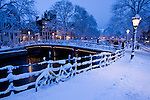 The canals in Amsterdam after a winter snow fall.