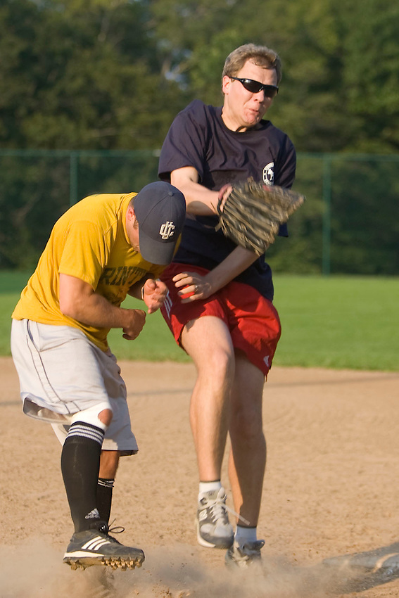 WETHERSFIELD-081811JT.Democrats' Rep. Matt Ritter and Republicans' Chris Fryxell collide at first during Thursday's charity softball game at Mill Woods Park in Wethersfield, organized by the state's Young Democrats and Young Republicans..Photo by Josalee Thrift
