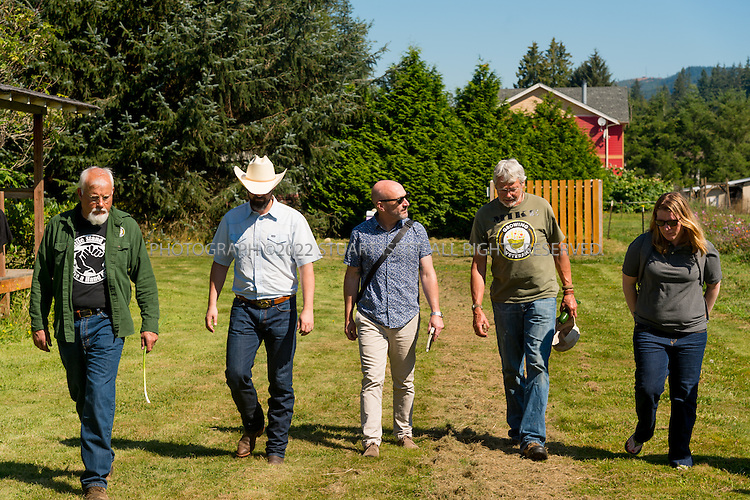 8/12/2016-- Mount Vernon, WA, USA<br /> <br /> Staff from the Schultz Family Foundation visit the Growing Veterans farm in Mt. Vernon, Washington, about an hour north of Seattle.<br /> <br /> Left to right:<br /> Kenny Holzemer, John  McCary (cowboy hat), Jason Raindorp, Mike Hackett,  Liz  Willett (foundation).<br /> <br /> From http://growingveterans.org:<br /> <br /> &ldquo;Since 2012, Growing Veterans has been combining veteran reintegration with sustainable agriculture. Our unique model addresses the growing desire for alternative therapies for Post-Traumatic Stress (PTS) and Traumatic Brain Injury (TBI), as well as suicide prevention through peer-support and Applied Suicide Intervention Skills Training (ASIST) certification. We encourage continued service through volunteerism, and collective impact through collaboration with other local, regional, and national stakeholders.&nbsp; We provide opportunities for vets in transition to develop their resumes and identify how to translate skills learned in the military to new roles in the civilian sector. Further, our vets serve as leaders in the important movement toward sustainable agriculture&rdquo;<br /> <br /> Photograph by Stuart Isett. &copy;2016 Stuart Isett. All rights reserved.