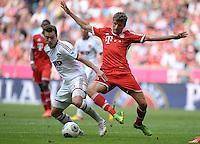 Fussball  1. Bundesliga  Saison 2013/2014  3. Spieltag FC Bayern Muenchen - 1. FC Nuernberg       24.08.2013 Thomas Mueller (re, FC Bayern Muenchen) gegen Hanno Balitsch (li, 1. FC Nuernberg)