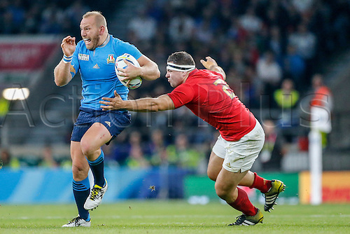 19.09.2015. Twickenham, London, England. Rugby World Cup. France versus Italy. Leonardo Ghiraldini of Italy evades the tackle of Guilhem Guirado of France.