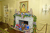 """Decorated fireplace mantel under the portrait of former first lady Lady Bird Johnson in the Vermeil Room as part of the 2015 White House Christmas theme """"A Timeless Tradition"""" at the White House in Washington, DC on Wednesday, December 2, 2015. <br /> Credit: Ron Sachs / CNP"""