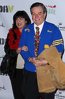 HOLLYWOOD, CA - DECEMBER 01: Teresa Modnick, Jerry Mathers arriving at the 82nd Annual Hollywood Christmas Parade held at Hollywood Boulevard on December 1, 2013 in Hollywood, California. (Photo by Xavier Collin/Celebrity Monitor)