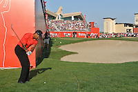 Tiger Woods (USA) after getting a drop from behind the stand during the final day of  the Abu Dhabi HSBC Golf Championship, Abu Dhabi GC,Abu Dhabi,United Arab Emirates.Picture Fran Caffrey www.golffile.ie