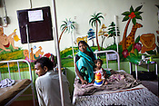 26 year old Anita is seen with her 18 month malnourished daughter, Rajni in the special Nutritional Rehabilitation Centre at the pediatrics department in Maharani Laxmibai Medical College in Jhansi, Uttar Pradesh, India. The Indian government spends $1.4 billion a year - on programs that include weighing newborn babies, counseling mothers on healthy eating and supplementing meals, but none of this is yeilding results. According to UNICEF, some 48% of Indian children, or 61 million kids, remain malnourished, the clinical condition of being so undernourished that their physical and mental growth are stunted. Photo: Sanjit Das/Panos for The Wall Street Journal.Slug: IMALNUT