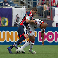 New England Revolution midfielder/defender Chris Tierney (8) and DC United defender Robbie Russell (3) at midfield. In a Major League Soccer (MLS) match, DC United defeated the New England Revolution, 2-1, at Gillette Stadium on April 14, 2012.
