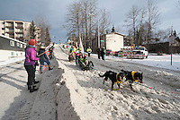 Monica Zappa and team run past spectators on the bike/ski trail with an Iditarider in the basket during the Anchorage, Alaska ceremonial start on Saturday, March 5, 2016 Iditarod Race. Photo by O'Hara Shipe/SchultzPhoto.com