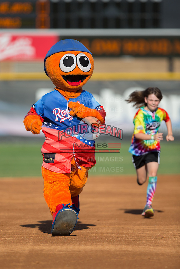 Burlington Royals mascot Bingo races a young fan around the bases between innings of the game against the Bluefield Blue Jays at Burlington Athletic Stadium on June 26, 2016 in Burlington, North Carolina.  The Blue Jays defeated the Royals 4-3.  (Brian Westerholt/Four Seam Images)