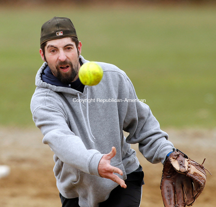 Waterbury, CT-28, March 2010-032810CM09  Jay Blasko of Waterbury, lobs a pitch at Huntington Park in Waterbury Sunday afternoon.  Blasko with the Wire Nuts of Waterbury, pitched against the Young's Farm Softball team of Woodbury, during a pre-season scrimmage..  The teams are apart of the Waterbury Slow Pitch Softball League.  The Wire Nuts won the pre-season game, 4-1.   --Christopher Massa Republican-American