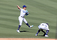 25th July 2020, Los Angeles, California, USA;  Los Angeles Dodgers Infield Enrique Hernandez (14) makes a throw to first base during the game against the San Francisco Giants on July 25, 2020, at Dodger Stadium in Los Angeles, CA.