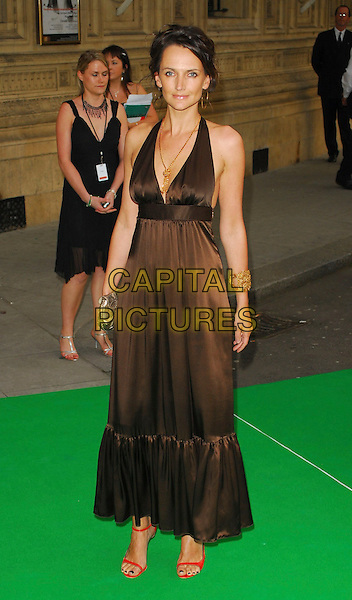 SAFFRON ALDRIDGE.At the Dream Auction Full Stop - VIP Party, primarily to launch children's charity NSPCC's There4Me online sevice. Held at the Royal Albert Hall, London, UK..May 9th 2006.Ref: CAN.full length brown satin halterneck dress.www.capitalpictures.com.sales@capitalpictures.com.©Capital Pictures