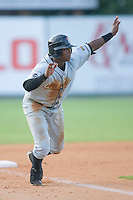 Tim Beckham #26 of the Bowling Green Hot Rods takes his lead off of third base versus the Kannapolis Intimidators at Fieldcrest Cannon Stadium August 23, 2009 in Kannapolis, North Carolina. (Photo by Brian Westerholt / Four Seam Images)