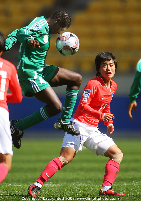 Martina Ohadugha controls the ball under pressure from Hee Young Park during the FIFA Women's Under-17 World Cup pool match between Korea and Nigeria at Westpac Stadium, Wellington, New Zealand on Thursday, 30 October 2008. Photo: Dave Lintott / lintottphoto.co.nz