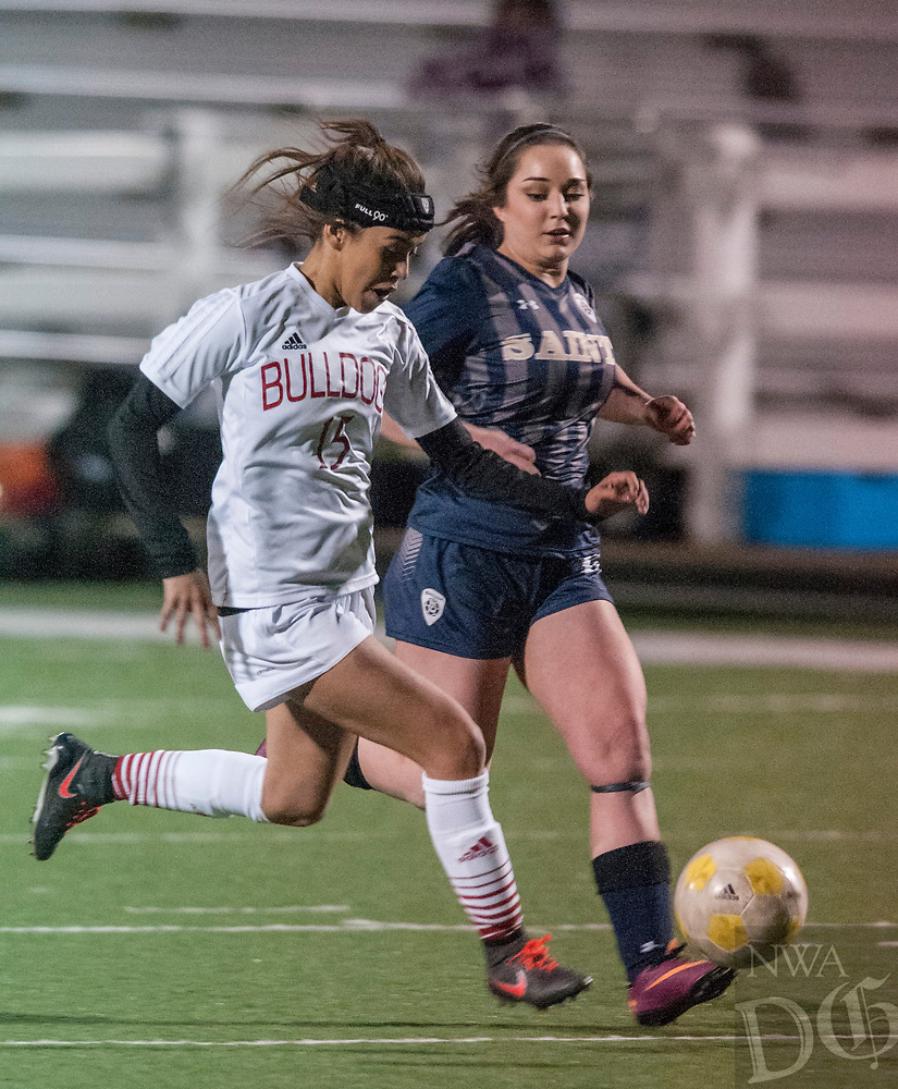 NWA Democrat-Gazette/ANTHONY REYES @NWATONYR<br /> Chela Razo (15) of Springdale runs down the ball against Taylor Larson of Shiloh Christian Tuesday March 7, 2017 at Jarrell Williams Bulldog Stadium in Springdale.