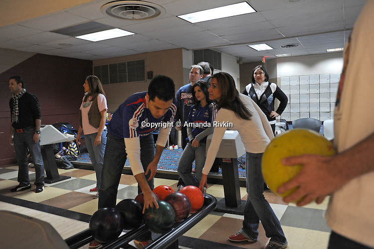 Afghan-American bowlers select bowling balls and await their turn in the Afghan Bowling Tournament in Annandale, Virginia on February 28, 2010.