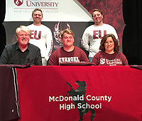 RICK PECK/SPECIAL TO MCDONALD COUNTY PRESS<br /> Tanner Harnar (center) recently signed a scholarship to cheer at Evangel University in Springfield, Mo. Shown above (left) is Jerry Harnar (dad), Tanner Harnar and Stacie Campbell (mom) with Carter Burns (back, left) and Brendan Hill both Evangel cheerleaders.