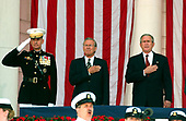 Washington, D.C. - May 29, 2006 -- United States President George W. Bush, right, listens to the national anthem prior to  making remarks at the annual Arlington National Cemetery Memorial Day Commemoration at Arlington National Cemetery in Arlington, Virginia  on May 29, 2006.  Frol eft to right: General Peter Pace, Chairman of the Joint Chiefs of Staff; United States Secretary of Defense Donald Rumsfeld; and President Bush.<br /> Credit: Ron Sachs  - Pool via CNP