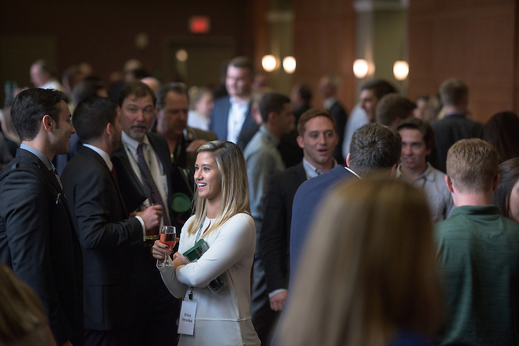 Erica Ytterbo, center, speaks with Corey Rex, left, during the networking hour following the 2016 Schey Sales Symposium held in Baker Center on November 3, 2016.