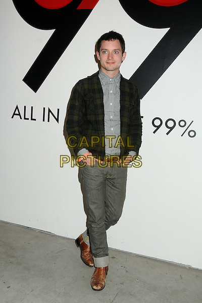 Elijah Wood.All In For The 99 Percent Event hosted by Van Jones, Rebuild The Dream and MoveOn.org held at 400 S La Brea, Los Angeles, California, USA, .31st March 2012..full length green tartan plaid jacket grey gray shirt jeans brown boots belt .CAP/ADM/BP.©Byron Purvis/AdMedia/Capital Pictures.