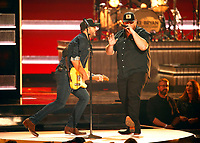 NASHVILLE, TN - NOVEMBER 14:  Luke Bryan and Luke Combs appear on the 52nd Annual CMA Awards at the Bridgestone Arena on November 14, 2018 in Nashville, Tennessee. (Photo by Frederick Breedon/PictureGroup)