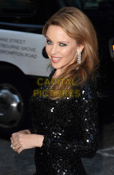 Kylie Minogue.'Holy Motors' UK film premiere at the Curzon Mayfair cinema, London, England..18th September 2012.half length dress side black sequins sequined dangling diamond earrings .CAP/ROS.©Steve Ross/Capital Pictures.