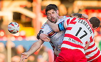 Picture by Allan McKenzie/SWpix.com - 17/04/2015 - Rugby League - Ladbrokes Challenge Cup - Wakefield Trinity Wildcats v Halifax RLFC - Rapid Solicitors Stadium, Wakefield, England - Wakefield's Mickael Simon offloads as he's tackled by Halifax's Mitch Calhane.
