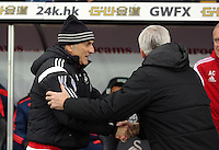 (L-R) Swansea head coach Francesco Guidolin greets Crystal Palace manager Alan Pardew before the Barclays Premier League match between Swansea City and Crystal Palace at the Liberty Stadium, Swansea on February 06 2016