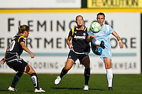 Meghan Schnur (12) of Sky Blue FC plays the ball in front of Brittany Bock (11) of the Los Angeles Sol. The Los Angeles Sol defeated Sky Blue FC 2-0 during a Women's Professional Soccer match at TD Bank Ballpark in Bridgewater, NJ, on April 5, 2009. Photo by Howard C. Smith/isiphotos.com