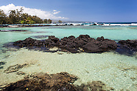 A swimmer enjoys on of the tide pools at Richardson Beach Park, Hilo, Big Island.