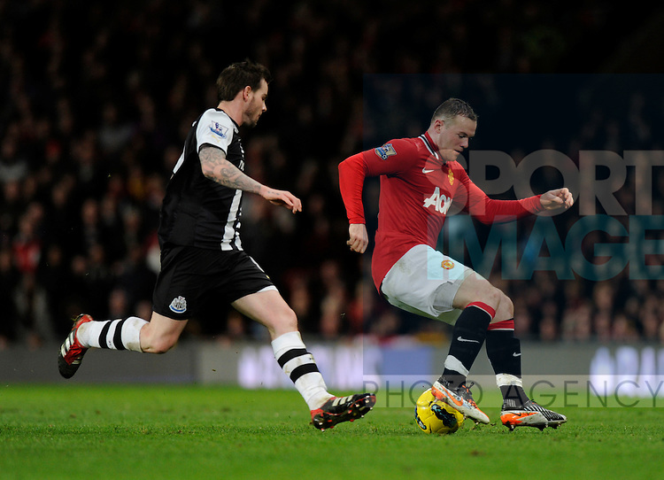 Wayne Rooney of Manchester United turns Danny Guthrie of Newcastle United