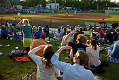 Fans shade their eyes from the evening sun during a Durham Bulls game at the old Durham Athletic Park, Monday, May 9, 2011.