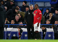 Manchester United's recent signing, Odion Ighalo is all smiles as he stands alongside Manager, Ole Gunnar Solskjaer and gets ready to make his debut as a second half substitute during Chelsea vs Manchester United, Premier League Football at Stamford Bridge on 17th February 2020