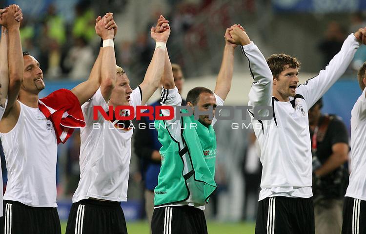 UEFA Euro 2008 Group B Klagenfurt - W&ouml;rthersee Match 04 Deutschland ( GER ) - Polen ( POL ) 2:0 (1:0). <br /> Kevin Kuranyi ( Germany / Angreifer / Forward / Schalke 04 #22 ), Bastian Schweinsteiger ( Germany / Mittelfeldspieler / Midfielder /  Bayern Muenchen #07 ), Oliver Neuville ( Germany / Angreifer / Forward / Gladbach #10 ) und Arne Friedrich ( Germany / Verteidiger / Defender /Hertha #03 ) (l-r) feiern den Sieg.<br /> <br /> Foto &copy; nph (  nordphoto  )