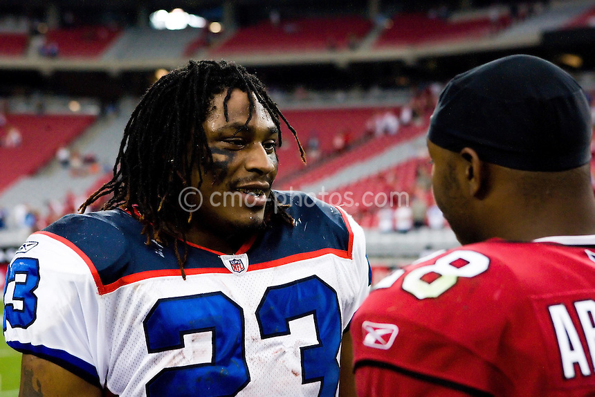Oct 5, 2008; Glendale, AZ, USA; Buffalo Bills running back Marshawn Lynch (23) and Arizona Cardinals running back J.J. Arrington (28), both former running backs for the California Bears, talk after a game between the Buffalo Bills and the Arizona Cardinals at University of Phoenix Stadium.  The Cardinals defeated the Bills 41-17.