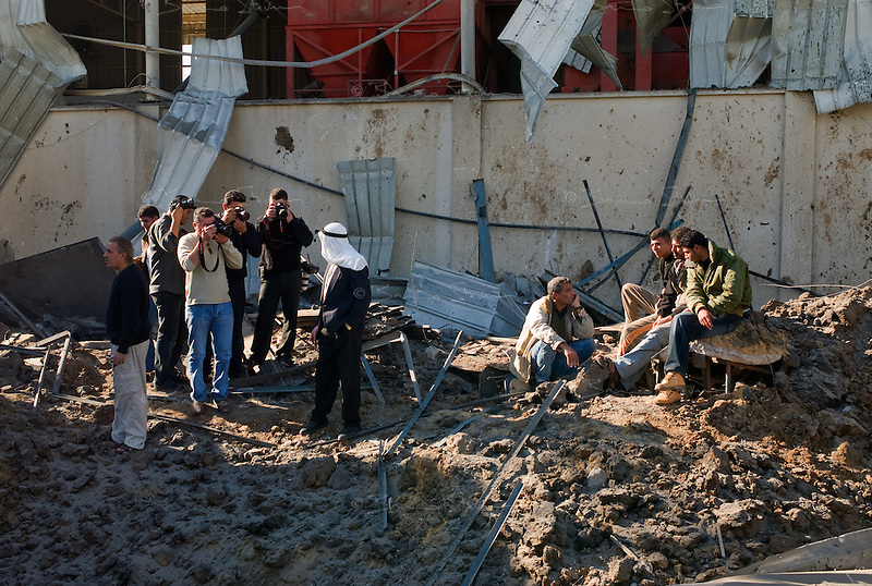 Zawaida, Gaza Strip, 22 Nov 2009.Almost a year after the 'Cast Lead' operation, an Israel Air Force F16 dropped 2 bombs on a metal workshop belonging to Md Namrutti, 65, (with the white keffieh) under the suspicion that it might have been used for building rockets.