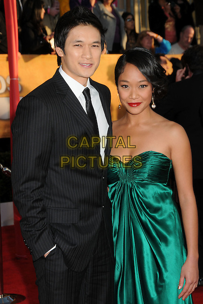 HARRY SHUM JR. & GUEST.16th Annual Screen Actors Guild Awards - Arrivals held at The Shrine Auditorium, Los Angeles, California, USA..January 23rd, 2009.SAG SAGs half length black pinstripe suit jacket green silk satin strapless dress hand in pocket .CAP/ADM/BP.©Byron Purvis/Admedia/Capital Pictures